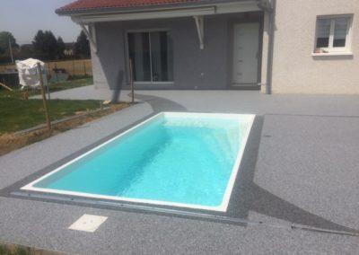 résines de sols extérieurs plage de piscine